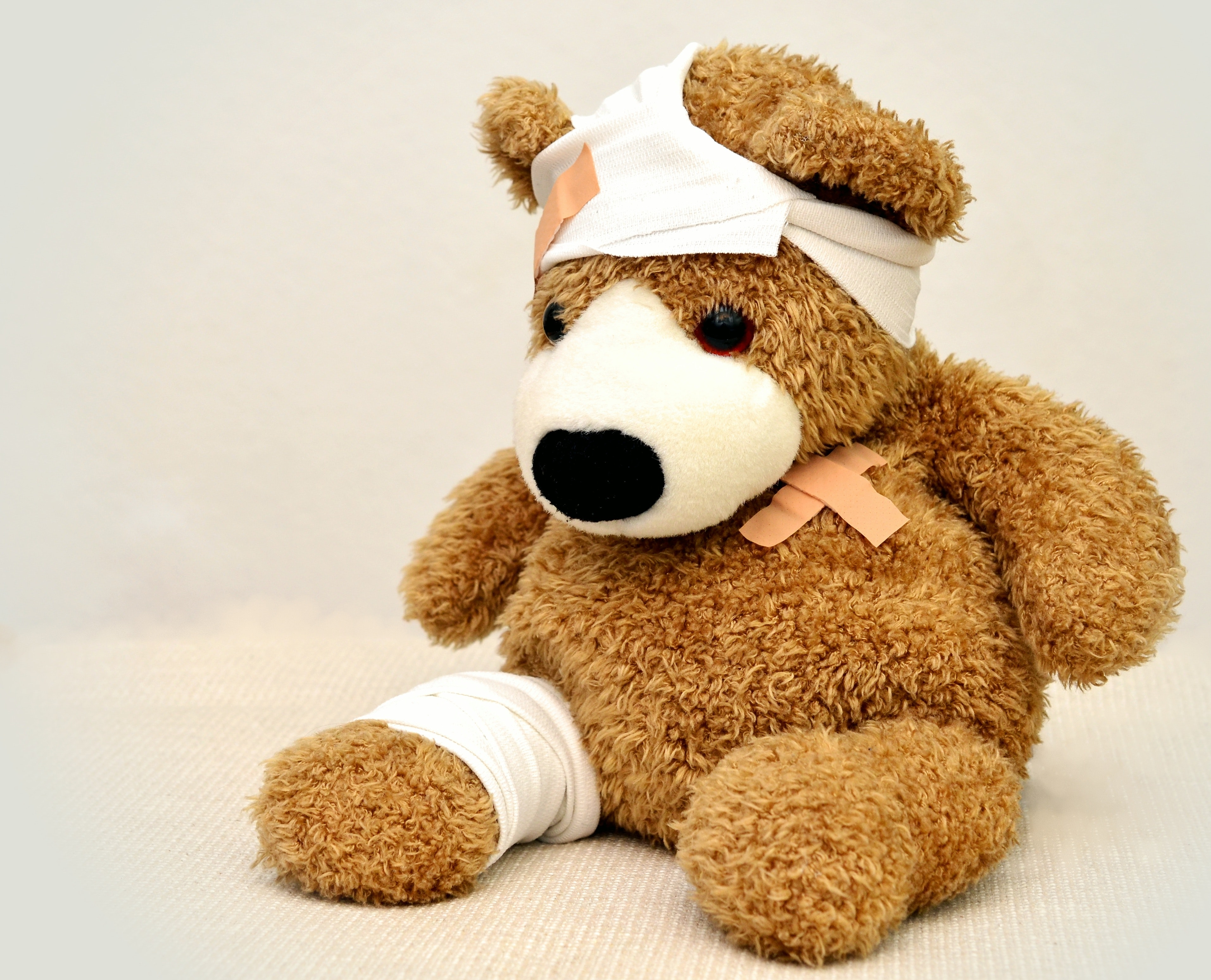 Stock photo of a brown teddy bear with a bandage around its head and another on its leg, and two band-aids crossed over one another on its chest. I mostly chose this image because I didn't want any graphic self-harm pictures and because it is adorable, like me.