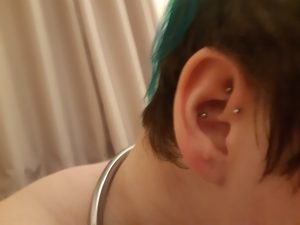 A photo of Morgan's ear, which has two piercings in it and is very cute