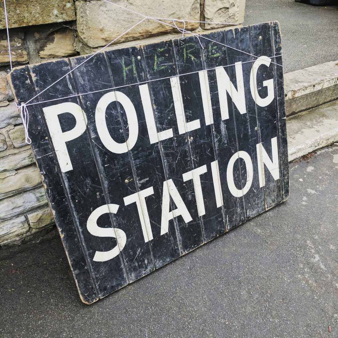 "A stock photo of a black sign which says ""Polling Station"" in white text, presumably from some other General Election that was less terrifying than this one"