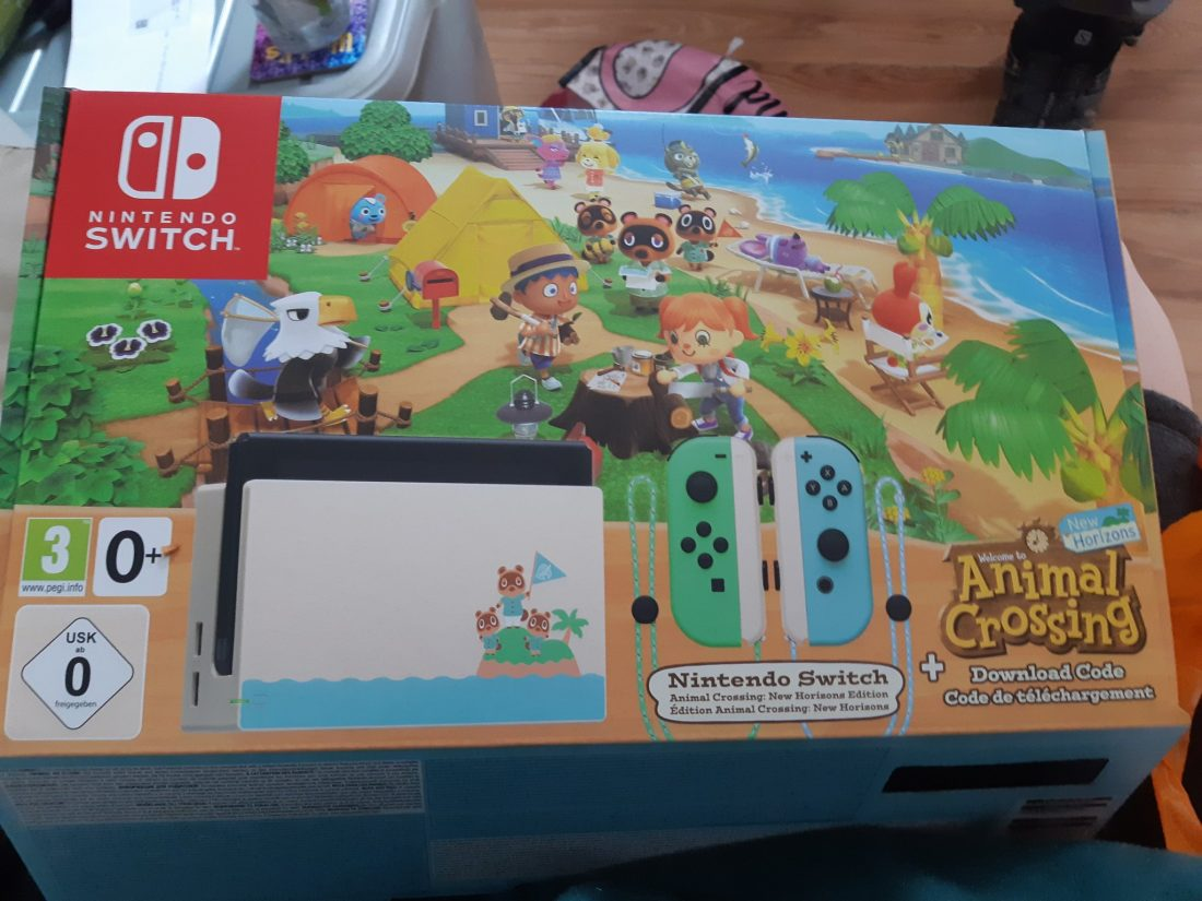 A poorly-taken photo of my new limited edition Animal Crossing Nintendo Switch!